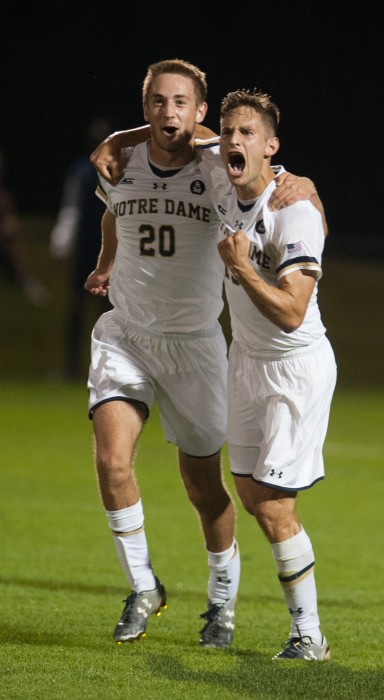 Sophomore defender Blake Townes, left, and senior midfielder Evan Panken celebrate a goal in a 3-1 victory again Virginia.