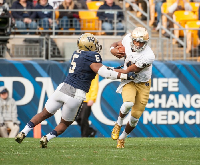 Irish sophomore quarterback DeShone Kizer evades a defender  during Saturday's 42-30 win over Pittsburgh at Heinz Field.