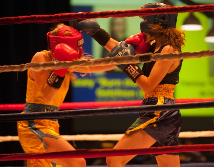 Junior Kelly Smith and sophomore Meg Hunt exchange punches  during Sunday's semifinal round of Baraka Bouts.