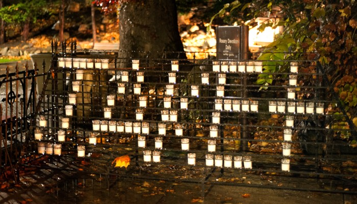 "Students spell out ""JAKE"" with candles at the Grotto in memory of Jake Scanlan who died Wednesday morning"