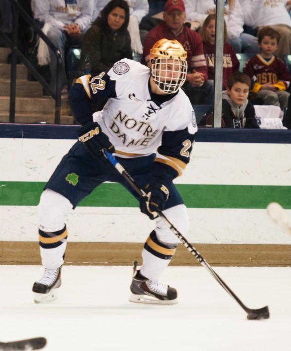Senior left wing Mario Lucia looks to pass during a 2-0 loss to Boston College on Feb. 27 at Compton  Family Ice Arena. The Irish host Northwestern for a pair of games Thursday and Friday this week.