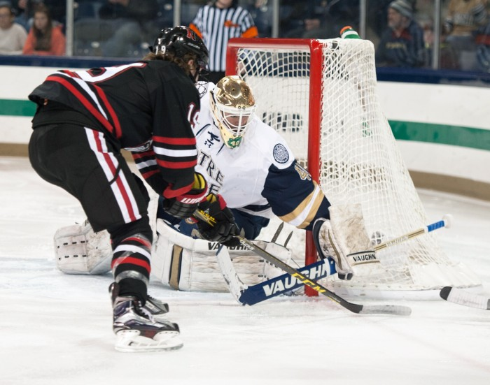 Irish sophomore goaltender Cal Petersen blocks a shot during Notre Dame's 3-2 victory over Northeastern on Thursday night at Compton Family Ice Arena. Peterson recorded 23 saves during the game.