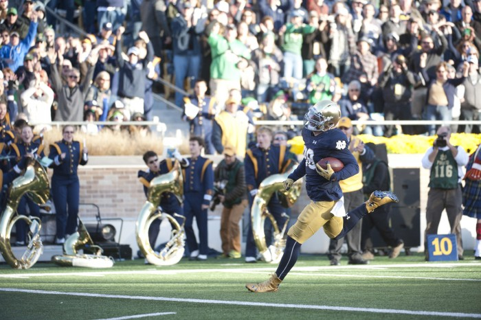 Irish sophomore defensive lineman Andrew Trumbetti runs into the end zone as he returns an interception for a 28-yard touchdown during Notre Dame's 28-7 win over Wake Forest on Saturday at Notre Dame Stadium. The interception was Trumbetti's first in just his second career start, and put Notre Dame up 14-0 late in the first quarter.