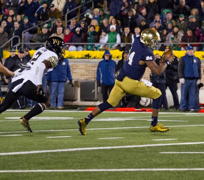 Irish sophomore quarterback DeShone Kizer carries the ball into the end zone to restore Notre Dame's three-score advantage in the fourth quaurter of Saturday's 28-7 win over Wake Forest.
