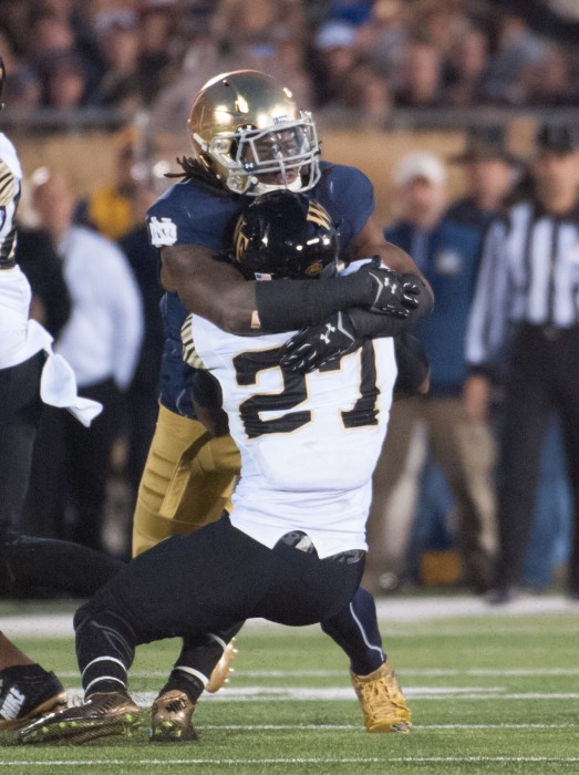 Irish junior linebacker Jaylon Smith tackles Wake Forest freshman running back Tyler Bell at Notre Dame Stadium on Saturday.