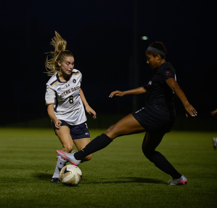Irish senior forward Anna Maria Gilbertson attempts to dribble past a defender during Notre Dame's 2-1 win over Santa Clara on Aug. 28.