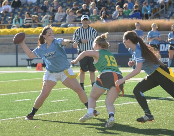 Whirlwind junior quarterback Rachel Wimsatt steps into a pass during Welsh Family's 26-7 win over Howard on Sunday.