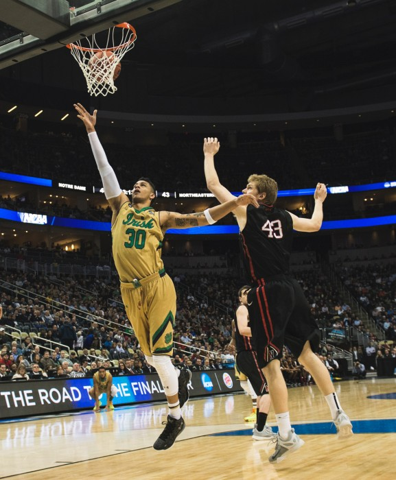 Irish senior forward and captain Zach Auguste shoots a layup during Notre Dame's 69-65 win over Northeastern on March 19.