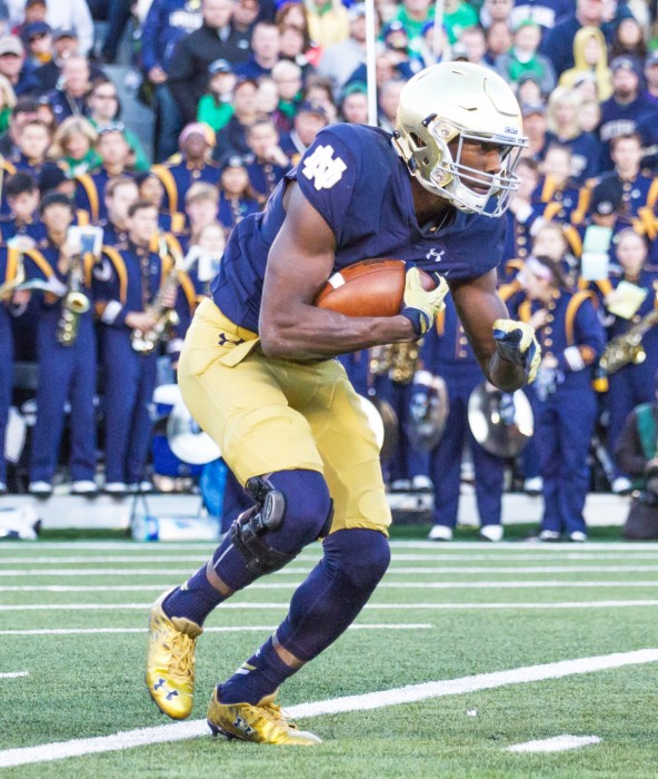 Freshman running back Josh Adams looks for a hole for a touchdown and an all-time Irish record for longest play from scrimmage.