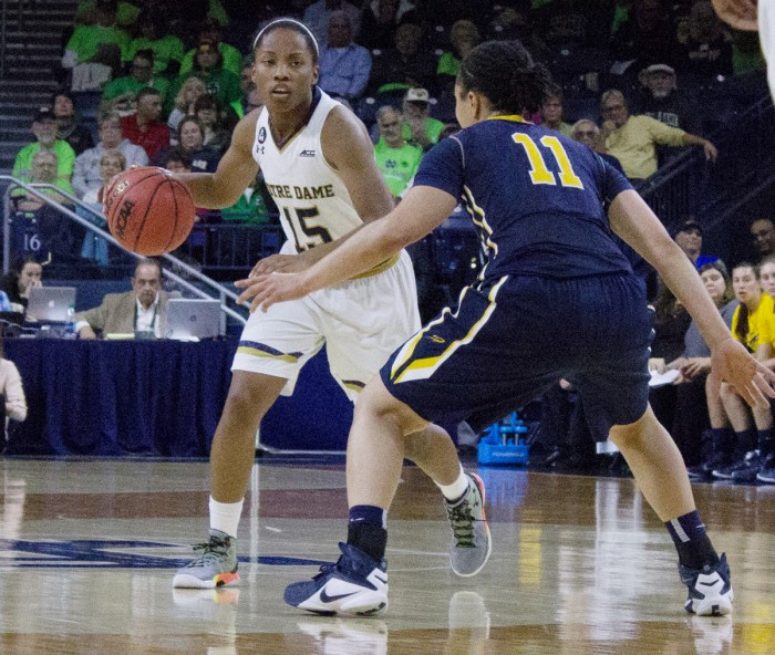 Junior guard Lindsay Allen sizes up a defender during the 74-39 Irish victory over Toledo at Purcell  Pavilion on Wednesday night. Allen had 10 points and nine assists in the win.