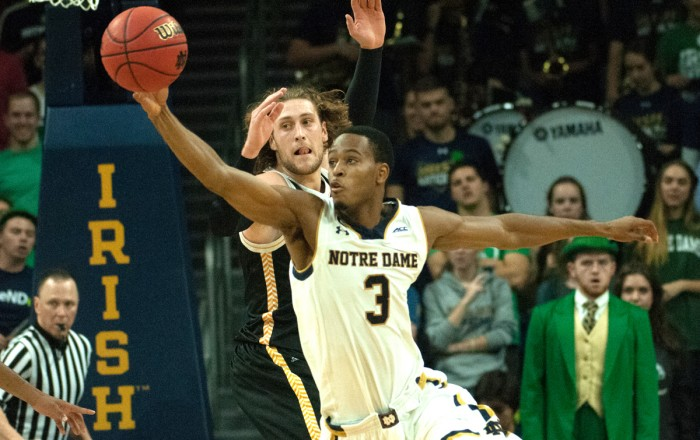 Sophomore forward V.J. Beachem reaches for a pass during an 86-78 victory over Milwaukee on Tuesday at Purcell Pavilion.