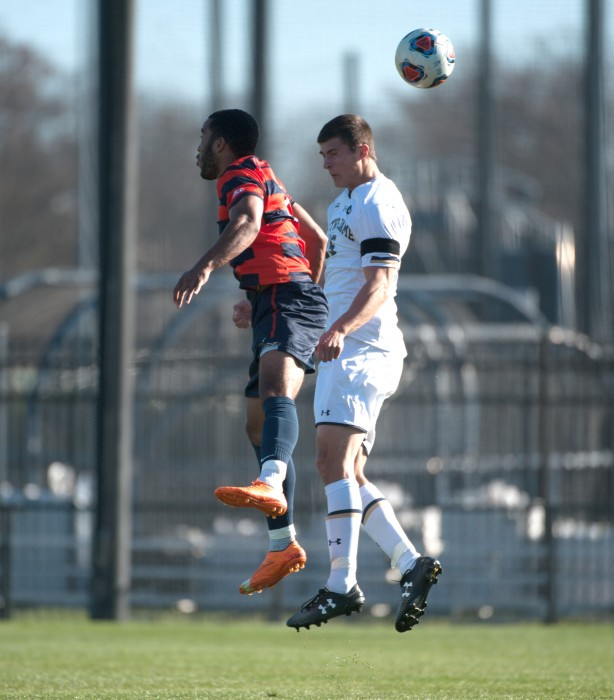 Senior midfielder Evan Panken jumps for a header in Notre Dame's 1-0 loss to Syracuse on Sunday in the ACC title game.