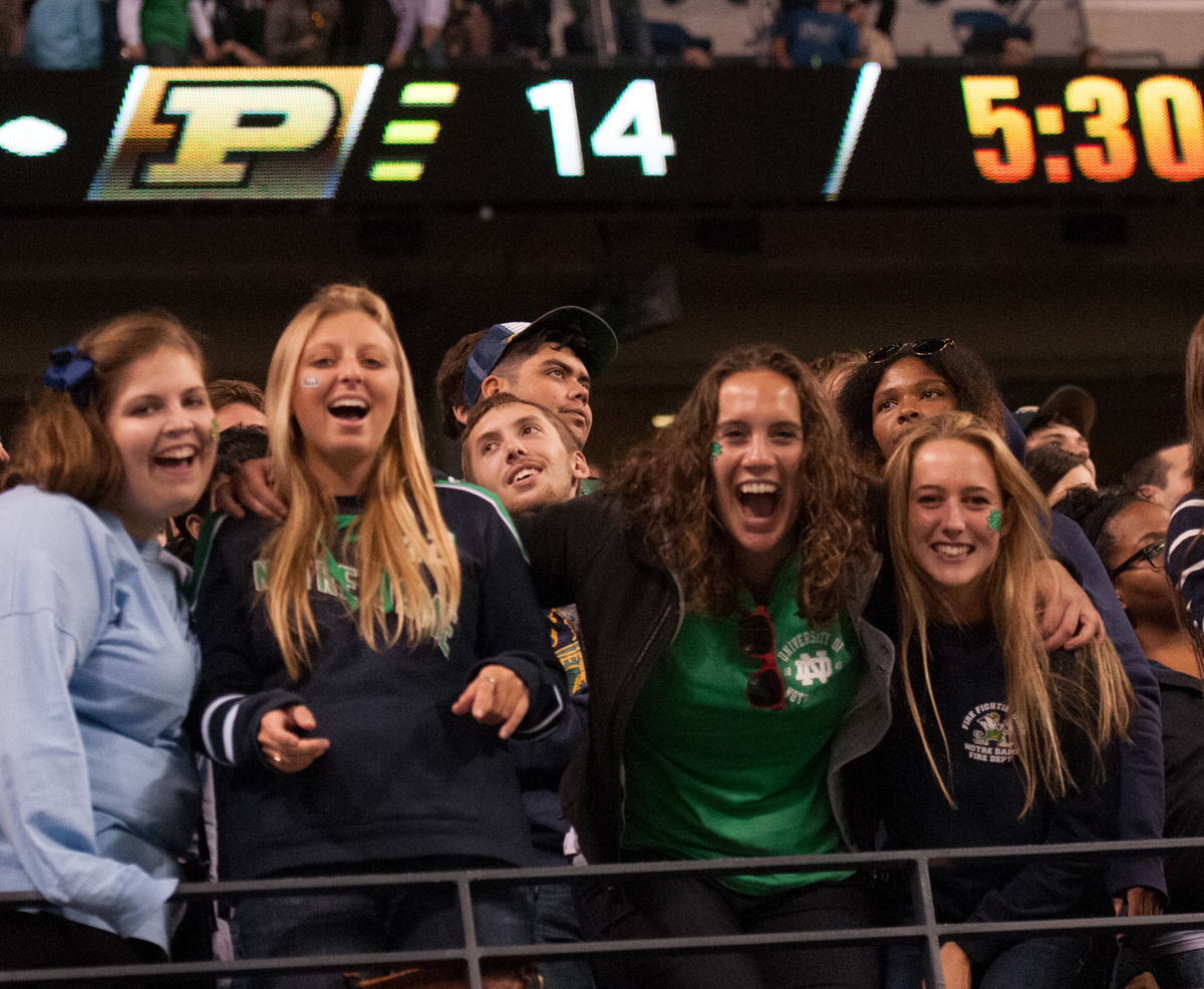 A group of students cheer on the Irish against Purdue in the Shamrock series in Lucas Oil Stadium on Sept. 13, 2014.