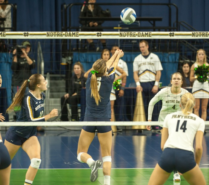 Sophomore setter Maddie Dilfer, left, passes the ball to freshman libero Ryann DeJarld during the 3-0 Irish loss to Pittsburgh on Nov. 8.