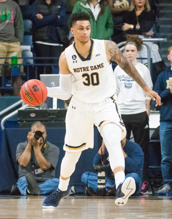 Senior forward Zach Auguste looks to pass during Notre Dame's 86-78 victory over Milwaukee on Tuesday night at Purcell Pavilion.
