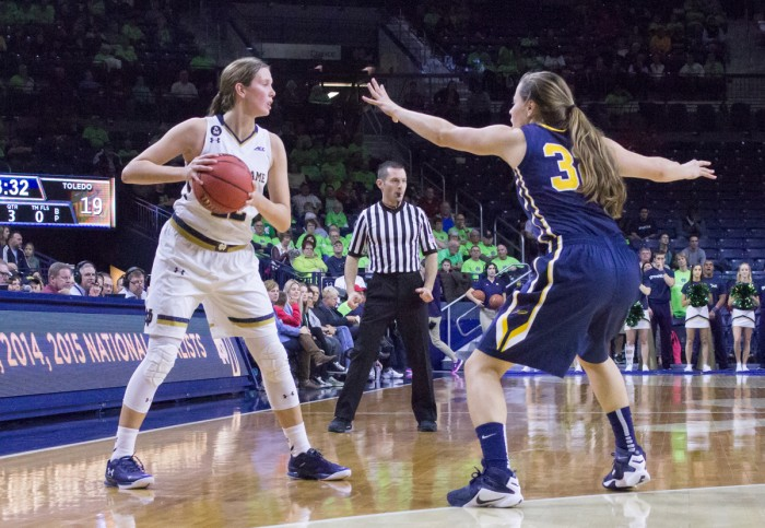 Graduate student guard Madison Cable looks for an open  teammate during Notre Dame's 74-39 victory over Toledo on Wednesday.
