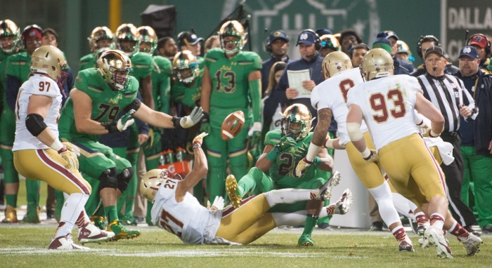 Irish senior running back C.J. Prosise, 20, loses control of the football during Notre Dame's 19-16 win over Boston College on Saturday at Fenway Park in Boston. The Eagles  recovered the fumble, one of Notre Dame's five turnovers in the game. Prosise left the game in the second quarter due to a high ankle sprain after running for 54 yards on nine carries.