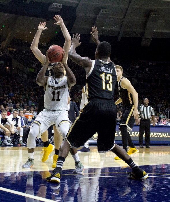 rish junior guard Demetrius Jackson throws a pump fake during Notre Dame's 86-78 over Milwaukee on Nov. 17 at Purcell Pavilion.