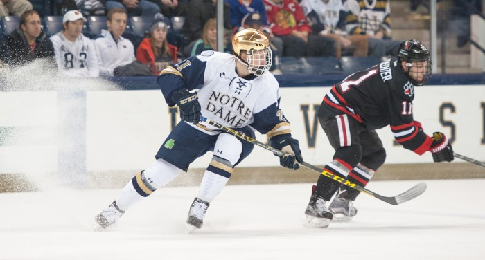 Freshman left wing Joe Wegwerth skates during Notre Dame's 3-2 victory over Hockey East opponent Northeastern on Nov. 12. The Irish continue conference play against UMass this weekend.