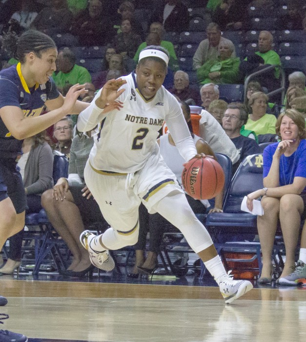 Freshman guard Arike Ogunbowale drives past a Toledo defender during Notre Dame's 74-39 win on Nov. 18 at Purcell Pavilion.
