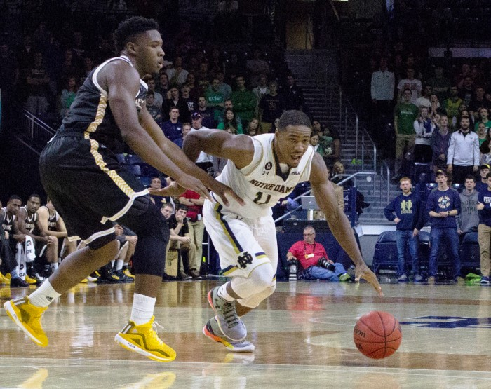 Junior guard Demitrius Jackson dribbles around a defender during Notre Dame's 86-78 victory over  Milwaukee on Nov. 17. Jackson led the team with 20 points in the win.