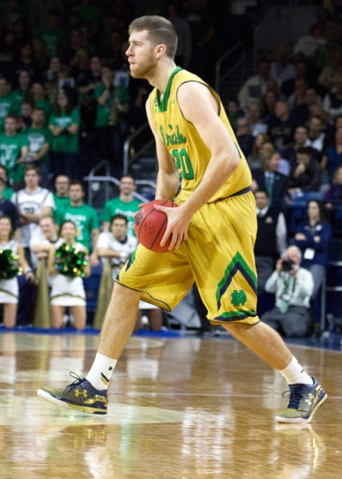 Irish senior forward A.J. Burgett looks to pass during Notre Dame's 76-49 win over Boston College at Purcell Pavilion on Jan. 23. In his first start in nearly two years, Burgett scored 14 points Sunday.
