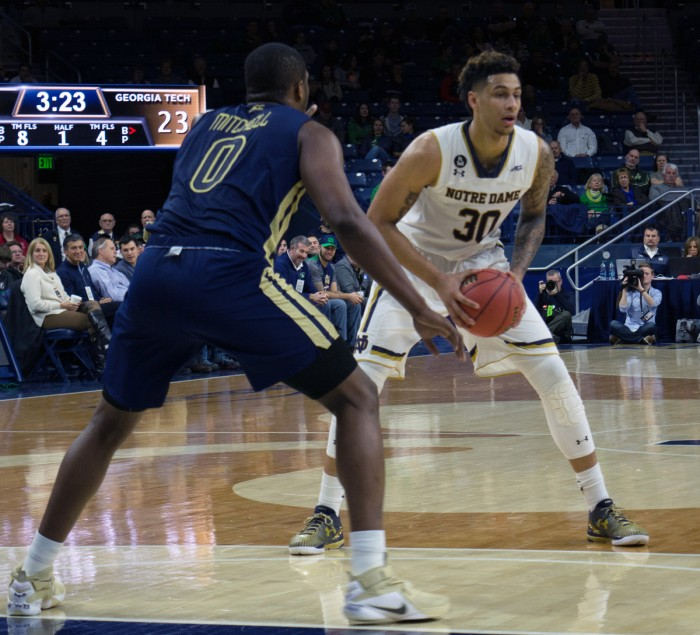 Senior forward Zach Auguste looks to pass during Notre Dame's 72-64 victory over Georgia Tech on Wednesday at Purcell Pavilion.  Auguste led the team with 24 points and nine rebounds.