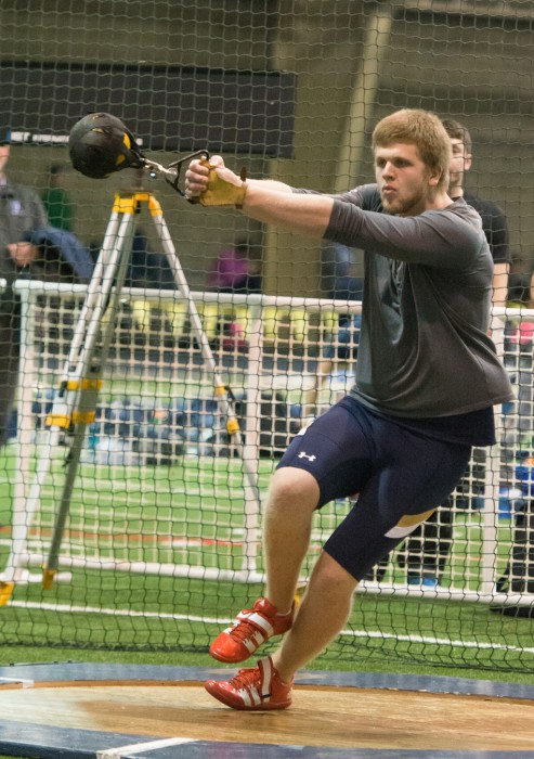 Junior weight thrower Anthony Shivers begins his throwing motion during the Blue and Gold Invitational on Dec. 5, 2014.