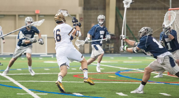 Irish senior midfielder Sergio Perkovic lines up a shot he scored on during Notre Dame's 14-12 win over Georgetown on Feb. 14.