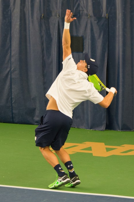 Irish sophomore Brendon Kempin gets ready to hit a serve during a 5-2 win over Indiana at Eck Tennis Pavilion.