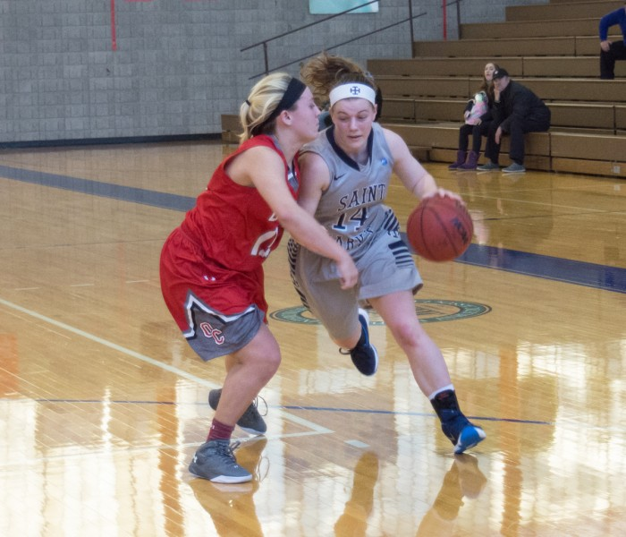 Saint Mary's freshman guard Erin Maloney attempts to drive past a defender during a 52-49 loss to Olivet on Jan. 23 at Angela Gym. Maloney had six points and four rebounds in the game.