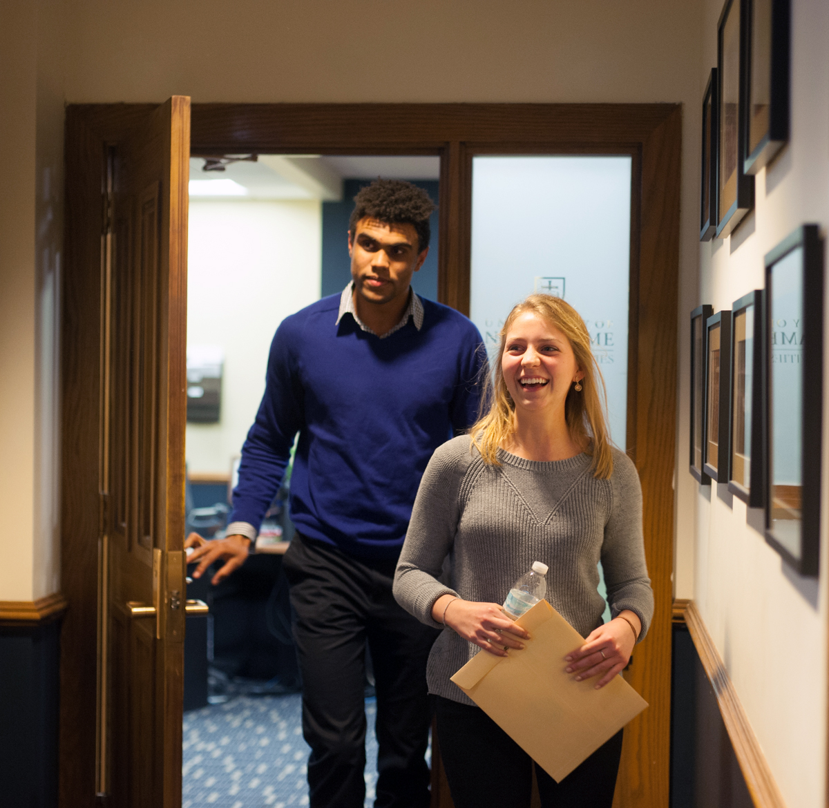 Corey Robinson and Becca Blais emerge from the Judicial Council office after receiving news they had won the student body election for president and vice president.