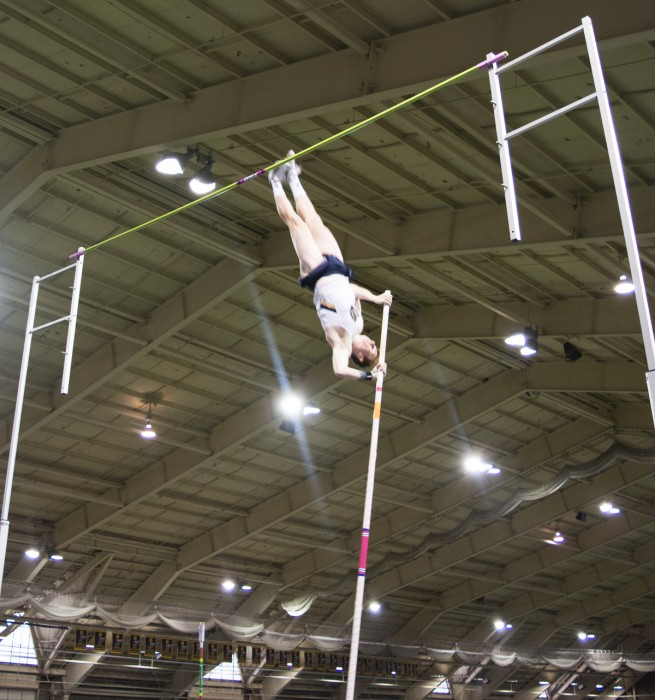 Junior Nate Richartz competes in the pole vault, which he won, at the Meyo Invitational at Loftus Sports Center on Feb. 6.