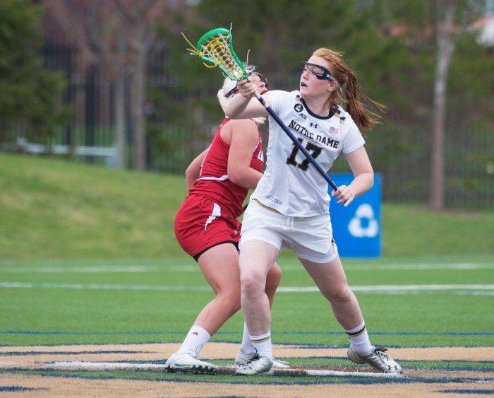 Irish graduate student defender Barbara Sullivan fights to retain possession during Notre Dame's 10-8 loss to Louisville on April 19.