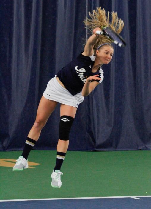 Irish junior Monica Robinson serves during Notre Dame's 7-0 win over Western Michigan on Jan. 19 at Eck Tennis Pavilion.