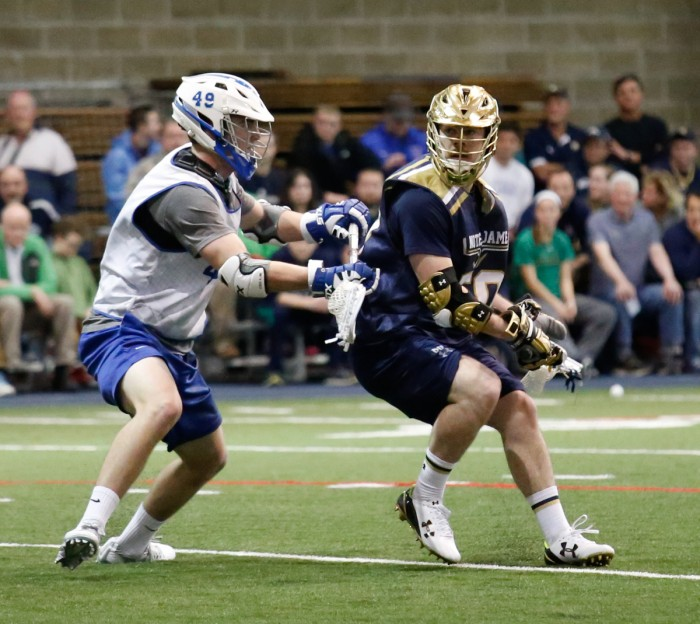 Irish senior attack Matt Kavanagh surveys his options during Notre Dame's scrimmage against Air Force on Jan. 30 at Loftus Sports Center. Kavanagh led the Irish with 52 points and scored 27 goals last season.