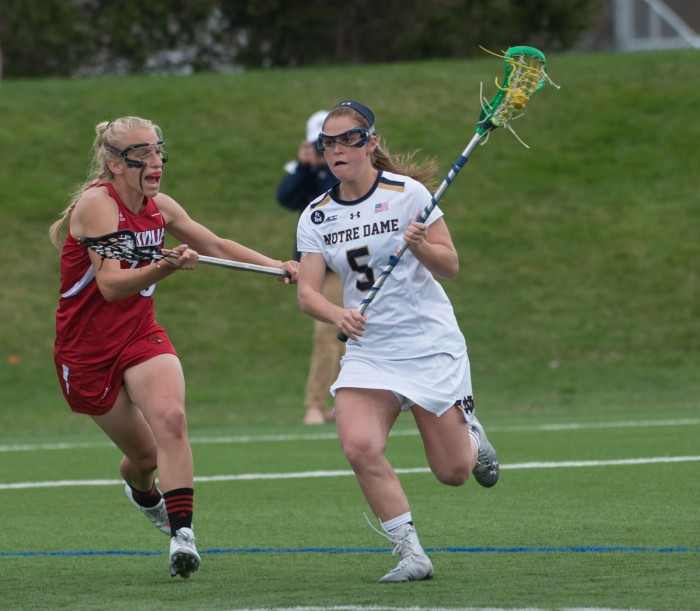 rish graduate student defender Barbara Sullivan possesses the ball during Notre Dame's 10-8 home loss to Louisville on April 19.