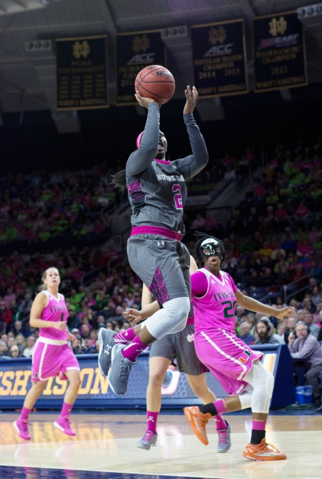 Irish freshman guard Arike Ogunbowale floats a shot while driving the lane during Notre Dame's 90-69 win over Miami (Fla.) on Sunday at Purcell Pavilion.