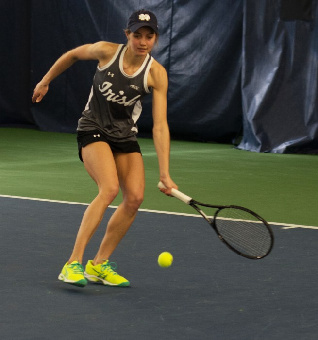 Irish junior Mary Closs reaches to return a shot during Notre Dame's 6-1 win over Indiana. Closs won her singles match, 6-3, 6-1.