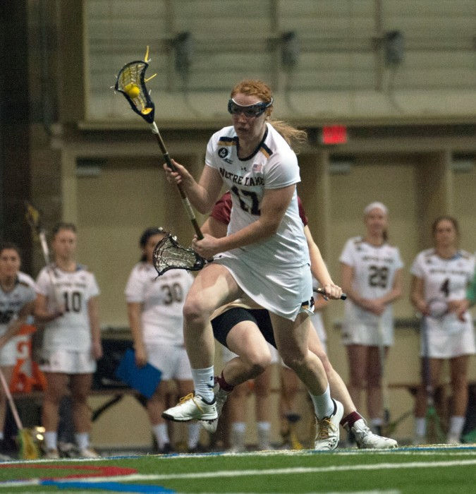 Irish graduate student defender Barbara Sullivan races upfield during Notre Dame's 14-4 victory over Boston College on Sunday at Meyo Field. Sullivan registered a game-high five draw controls in the win.