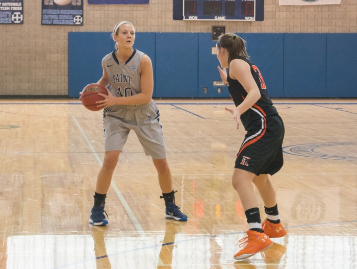 Senior forward Eleni Shea looks to make a pass during a 74-66 loss to Kalamazoo on Feb. 13 at Angela Gym. The Belles finished off their season with a 75-51 loss at Albion this past Saturday.