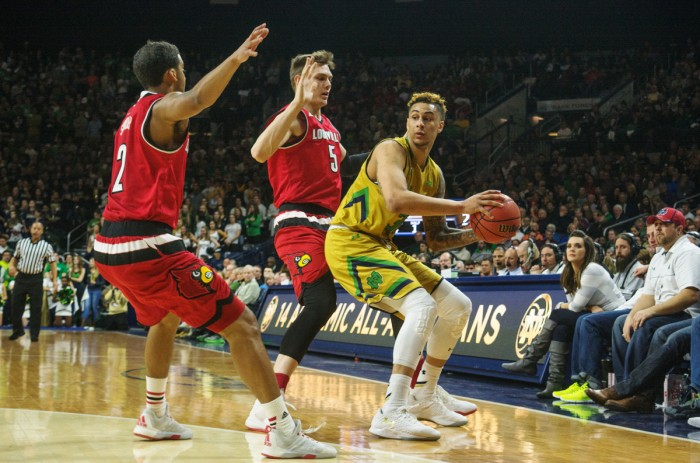 Irish senior forward Zach Auguste looks for an open teammate during Notre Dame's 71-66 win over Louisville on Feb. 13 at Purcell Pavilion. Auguste is questionable for Wednesday with a knee injury.