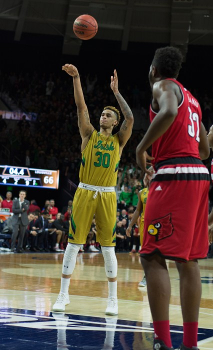 Irish senior forward Zach Auguste shoots a free throw during Notre Dame's 71-66 win over Louisville on Feb. 13 at Purcell Pavilion.
