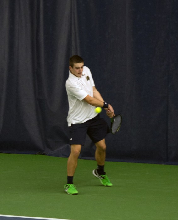 Irish freshman Nathan Griffin steps into a backhand during Notre Dame's 7-0 win over Ball State on Feb. 7 at Eck Tennis Pavilion.