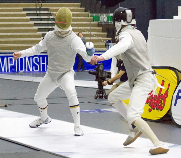 Sophomore foil Virgile Collineau lunges toward his opponent the ACC championships at Castellan Family Fencing Center on Sunday.