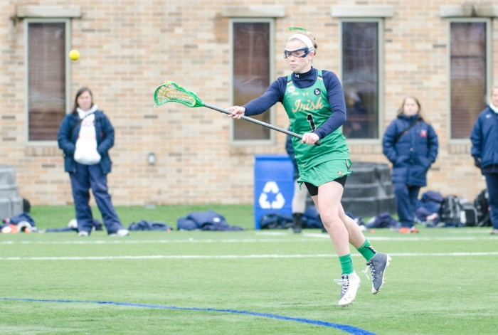 Irish senior attack Kiera McMullan makes a pass during Notre Dame's 16-4 victory over Virginia on March 19 at Arlotta Stadium.