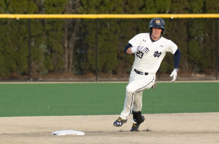 Junior second baseman Cavan Biggio rounds second base during Notre Dame's 9-5 victory over UIC on March 22 at Frank Eck Stadium.