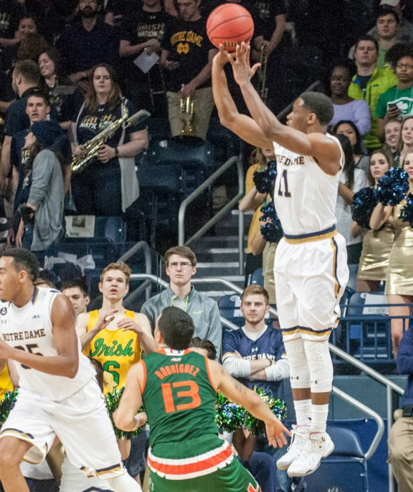 Junior guard Demetrius Jackson shoots a three-pointer in Notre Dame's 68-50 loss to Miami at Purcell Pavlion.