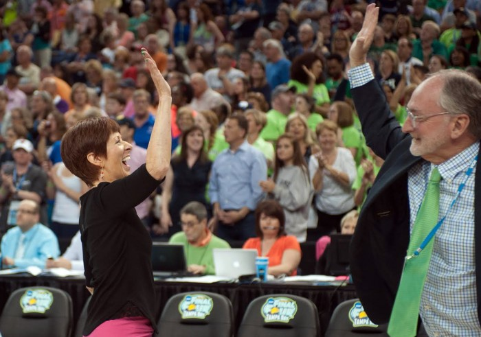 Irish head coach Muffet McGraw high-fives Director of Athletics Jack Swarbrick after Notre Dame's last-    second, 66-65 win over South Carolina in the national semifinal April 5 at Amalie Arena in Tampa, Fla.