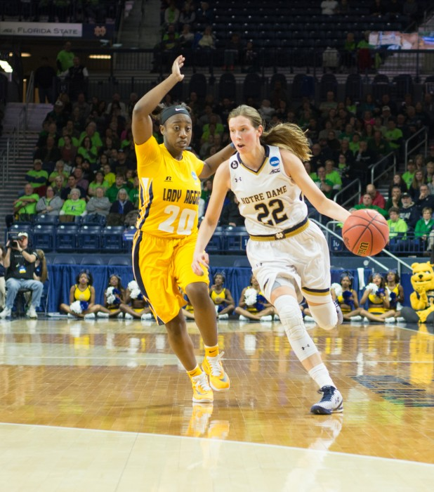 Irish graduate student guard Madison Cable dribbles around a North Carolina A&T defender during Notre Dame's 95-61 win in the first round of the NCAA tournament Saturday at Purcell Pavilion.